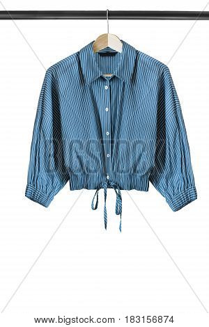 Blue striped shirt on wooden clothes rack isolated over white