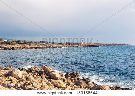 Shipwreck surrounded by sea waves on beach, Cyprus.