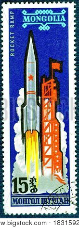 MONGOLIA - CIRCA 1963: Postage stamp printed in Mongolia shows picture Soviet space rocket, the series