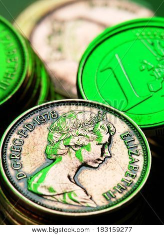 Pence coin; Euro on a background of coins