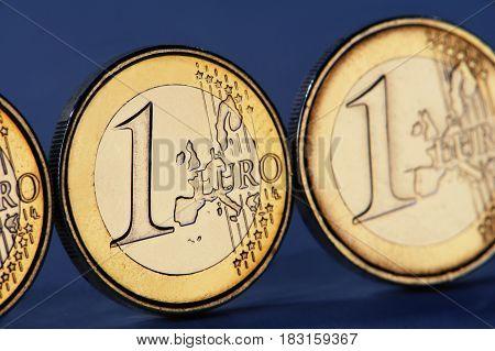 euro coin on a dark blue background