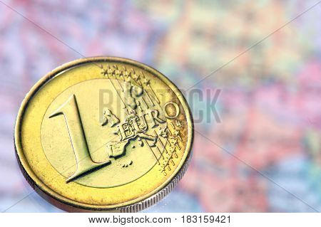 1 euro a coin on a background of a card