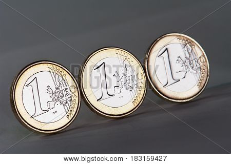 the euro coin on a grey background