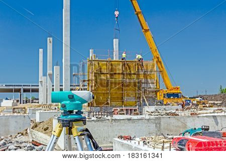 Surveyor instrument is for measuring level on construction site. Surveyors ensure precise measurements before undertaking large construction projects.