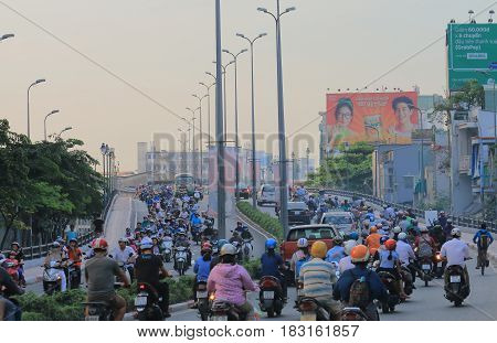 HO CHI MINH CITY VIETNAM - NOVEMBER 28, 2016: Unidentified people commuter in heavy traffic.