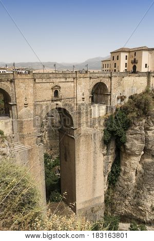 RONDA, SPAIN - JULY 20, 2016: Ronda (Andalucia Spain): view of the historic city over the canyon the famous bridge