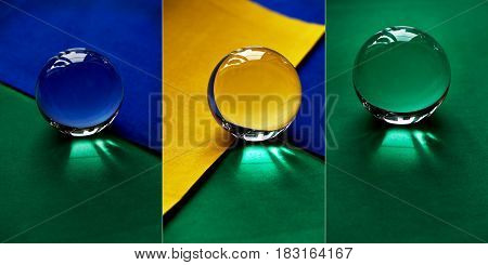 Glass globe or drop of water on a background of green, yellow and blue velvet paper. Clean and Shine
