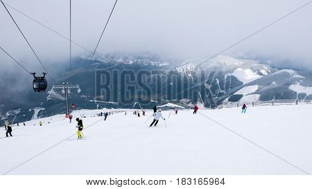 Jasna Chopok Slovakia 6 March 2017 - Cable car and skiers on the in ski resort Chopok in Slovakia. Tatra lower mountains.