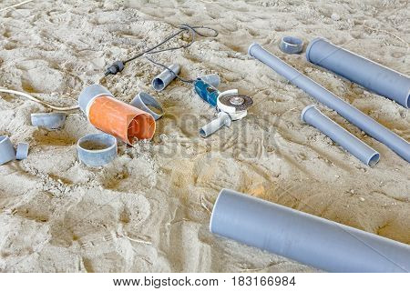 Place for adjusting PVC pipes with grinding machine on correct pipe measure to fit in.