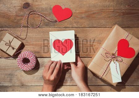 Valentine's Decorated Gift Box Over Wooden Background. View From Above