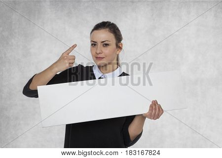 Beautiful woman holding a blank billboard space for link