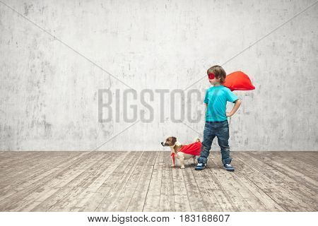Little boy with dog in studio