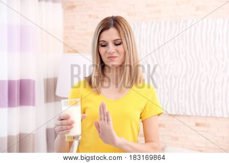 Woman with milk allergy at home