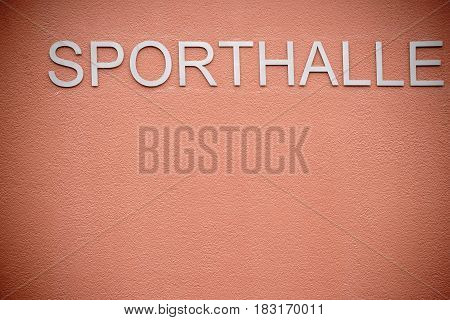 The facade of the freshly cleaned and new wall of a modern sports hall.