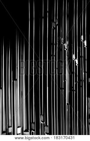 The closeup of shiny metal organ pipes.