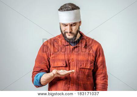 Sad Injured Bandaged Man With Pills