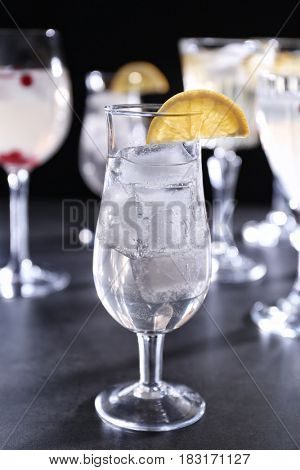 Refreshing cocktail with lemon slice on table