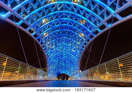 The Bridge of Peace is a bow-shaped pedestrian bridge, a steal and glass construction illuminated with numerous LEDs, over the Kura River in downtown Tbilisi, capital of Georgia.