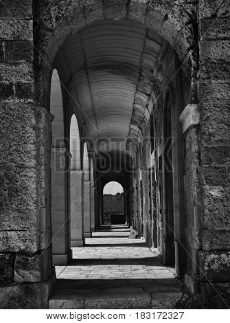 Corridor with columns in black and white selenium photo, abstract architectural photo, black and white photo, columns, diagonal, street photography. Architectural details. Fort Manoel, Malta