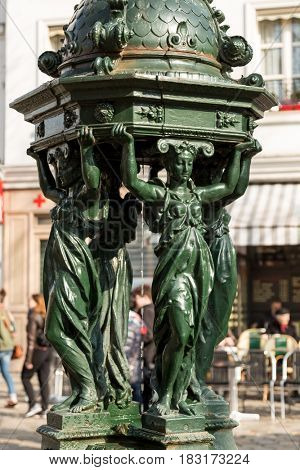 One of the drinking antique Wallace fountains with women group sculpture on in Paris