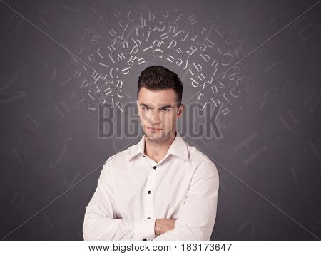 Young casual businessman with white alphabet around his head