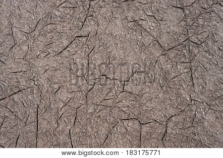 Cracked on wall or earth texture, brown background
