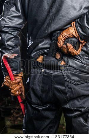 Burglary Holding Crowbar And Gun At Night