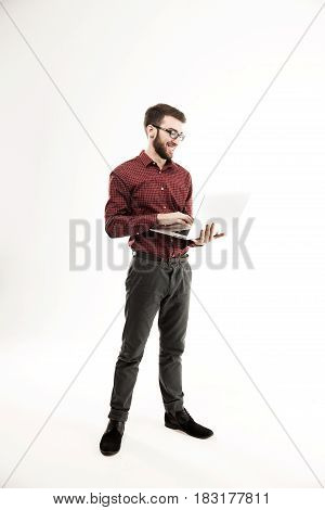portrait in full growth - the system administrator with a laptop against white background.the photo has a empty space for your text