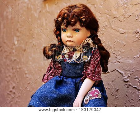 vintage porcelain doll sitting sad girl crying