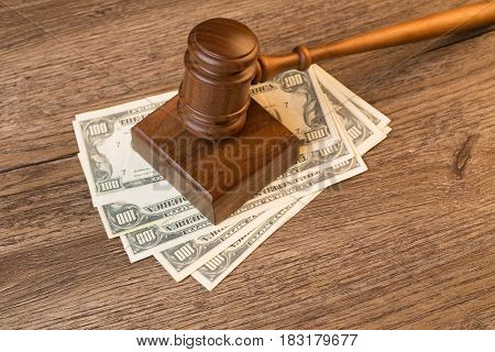 Photo of hammer on banknotes