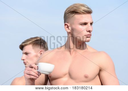 Two Men Posing On Sky Background With Serious Face