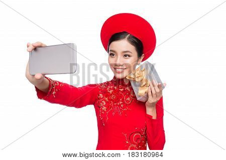Charming Vietnamese Woman In Red Ao Dai Traditional Dress Holding Gift Box.