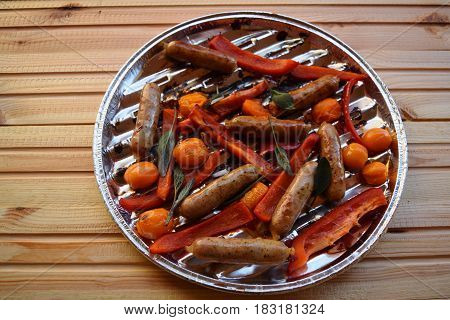 Grilling sausages and vegetables and spices on the grill