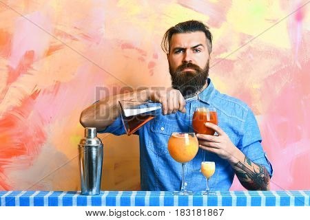 Brutal Caucasian Hipster With Alcoholic Cocktails And Bar Stuff
