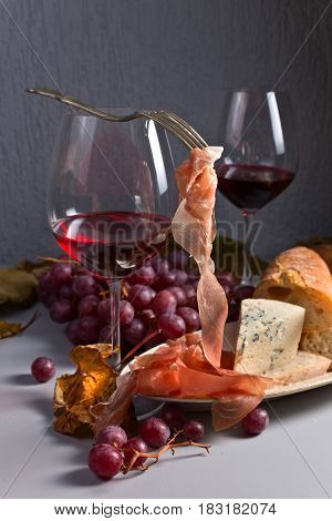 Red Wine With Snack And Grapes .