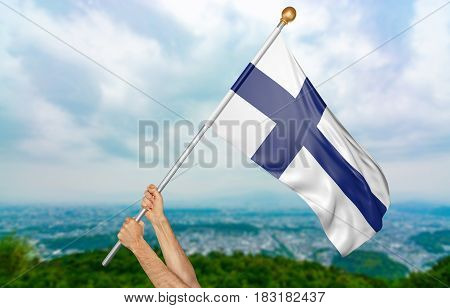 Young man's hands proudly waving the Finland national flag in the sky, part 3D rendering