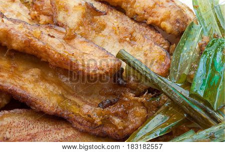 Closeup To Fried Bananas And Pandan Leaves Background