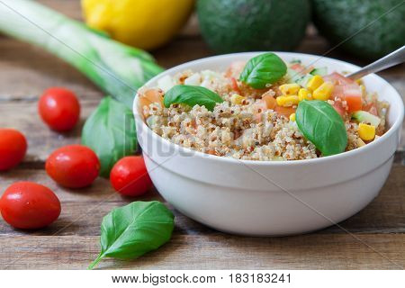 Healthy quinoa vegan salad with basil leaves