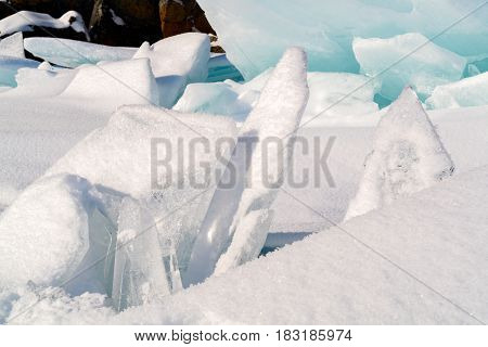 Ice blocks cover with snow at Lake Baikal in Russia