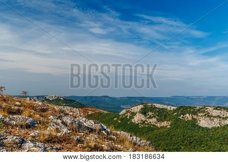 The mountain view with the nice blue sky and little light clouds in the warm sun light if afternoon in Crimea, Ukraine