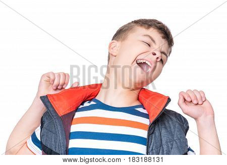 Emotional portrait of caucasian teen boy. Young sleepy handsome teenager yawning stretching arms. Studio shot - isolated on white background.