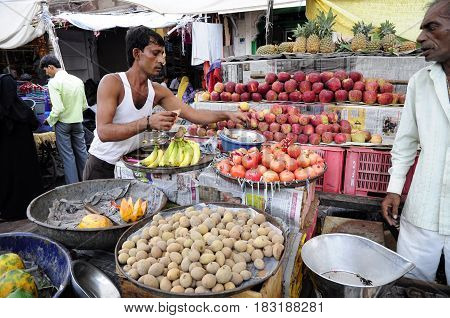 Jodhpur India september 10 2010: Young men selling vegetables and fruits on a localstreet market in Udaipur.