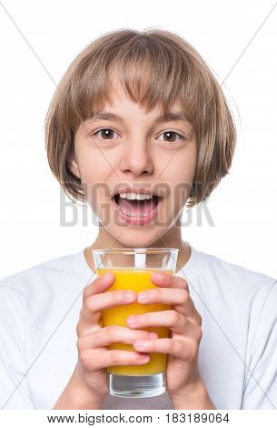 Beautiful caucasian little girl drinking fresh orange juice. Emotional portrait of attractive happy child with glass, isolated on white background.
