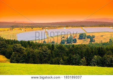 Landscape with solar power plant panel field. Clear energy and renewable resources theme.
