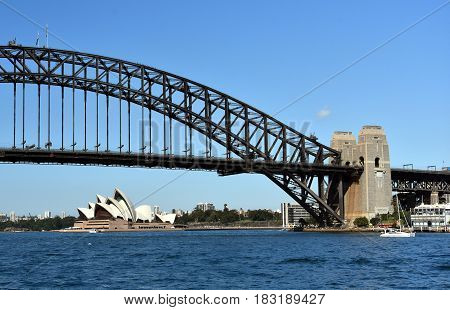 Sydney Australia - Apr 23 2017. Opera House and Harbour Bridge from McMahons Point Ferry Wharf on a sunny day.