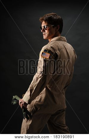 The sexy military man is looking off
