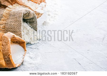 Packs of flour and sugar on the concrete background. Close up. Space for your text or logo