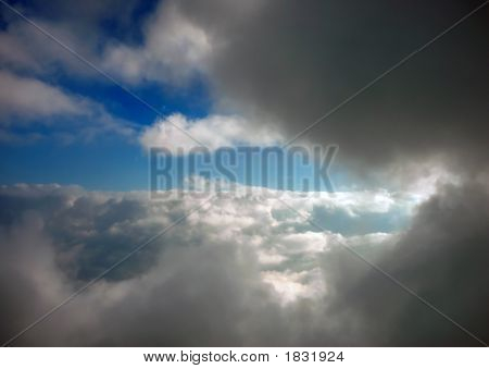 poster of puffy clouds in the high atmosphere background