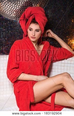Spa woman. Beautiful girl after bath in jacuzzi spa, relaxing after massage, wrapped in towels. Skincare. Perfect smooth young exfoliated skin. Woman pleased with the results from the spa treatments