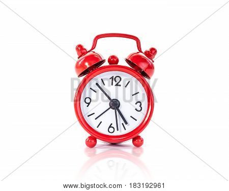 red metal alarm clock vintage style islolated on white background